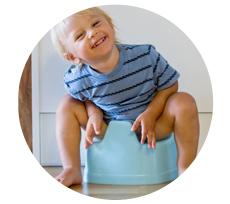 Barn som sitter på pottan
